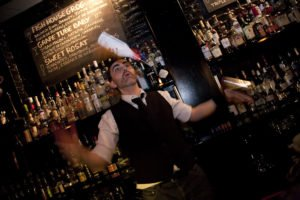 bartender with flair bottle in air
