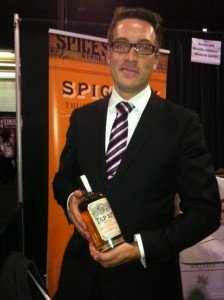 man in suit with tie holding spiced rum
