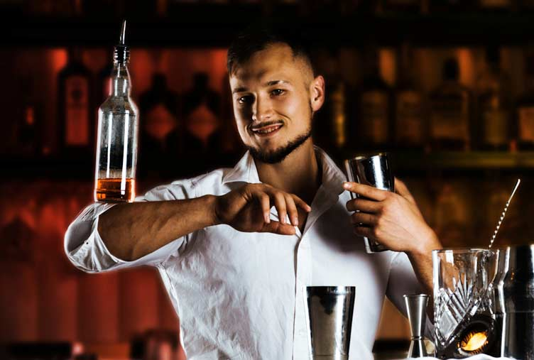Student practicing flair bartending course.