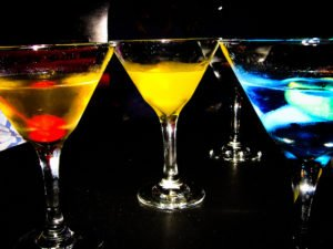 3 martini glasses with blue red and yellow