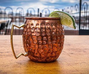 moscow mule in copper mug with lime wedge garnish