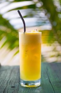 creamsicle cocktail with tropical background