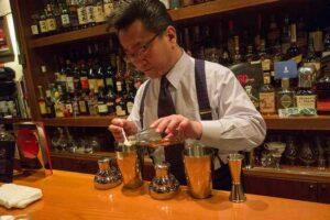 hands-on bartending mixing drinks