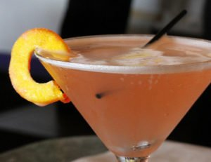 paradise cocktail as martini with peach garnish
