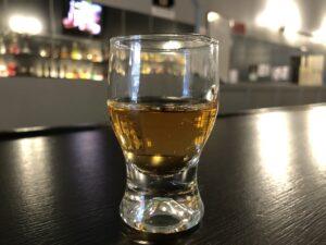 aged spirit in short tasting glass