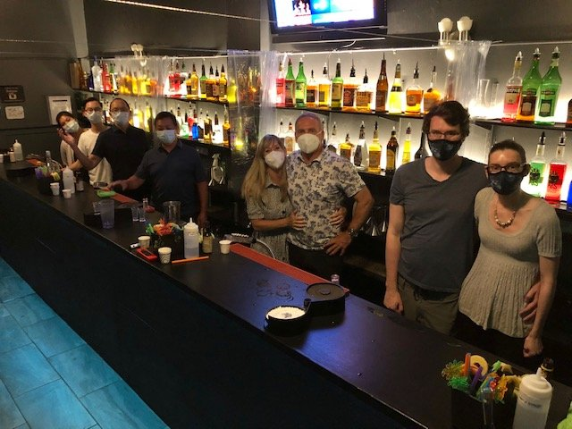 8 people in masks for intro to bartending class